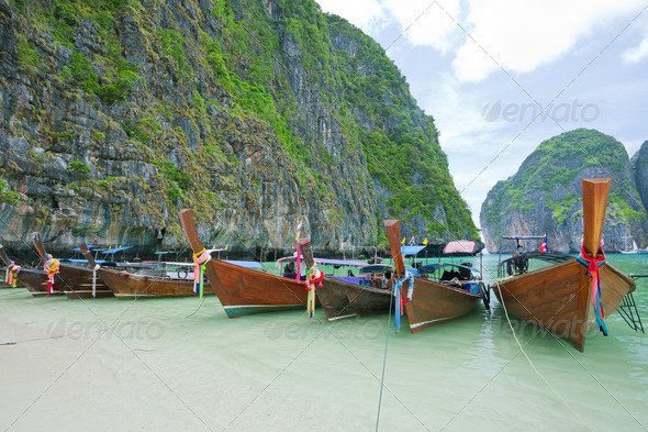 Cliff and boats - Stock Photo - Images