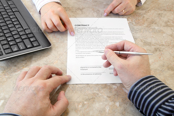 Signing a Contract - Stock Photo - Images