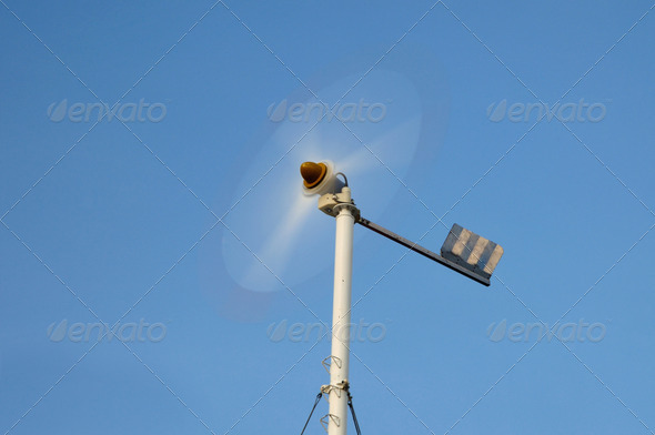 Spinning mini wind turbine on blue sky at Phuket, Thailand. - Stock Photo - Images