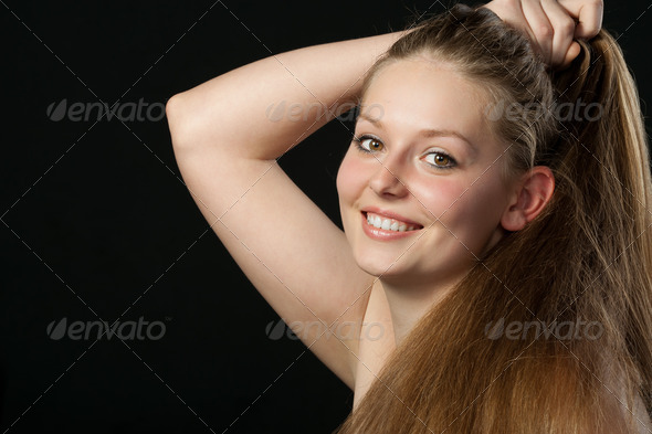 A portrait close up of the beautiful girl with long hair - Stock Photo - Images
