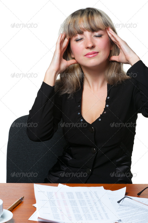 Headache. The business woman on the workplace tired of work - Stock Photo - Images