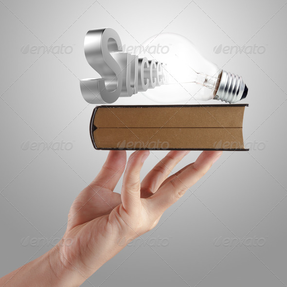 hand shows book of  success - Stock Photo - Images