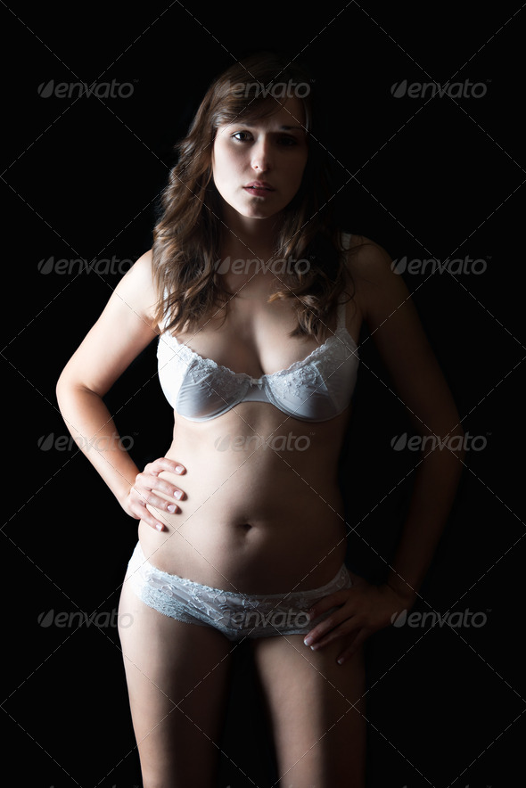 Portrait of a  young woman in beautiful white underwear - Stock Photo - Images