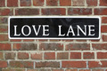 Street Sign For Love Lane On Brick Wall - PhotoDune Item for Sale