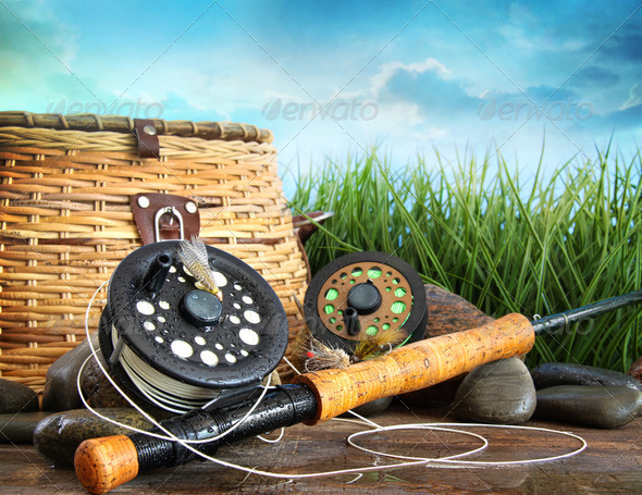 Flly fishing equipment and basket - Stock Photo - Images