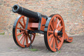 Old medieval artillery canon before a brick wall - PhotoDune Item for Sale