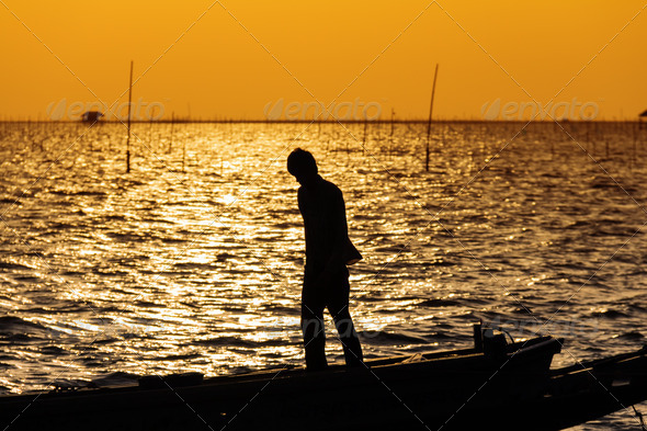 Silhouette of fisherman - Stock Photo - Images