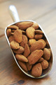 Scoop Of Almonds On Wooden Surface - PhotoDune Item for Sale