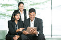 Indian Business people looking at a digital tablet. - PhotoDune Item for Sale