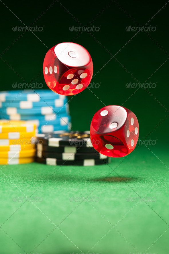 Rolling red dice - Stock Photo - Images