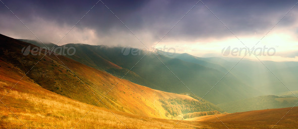 Mountains hills and sunbeams - Stock Photo - Images