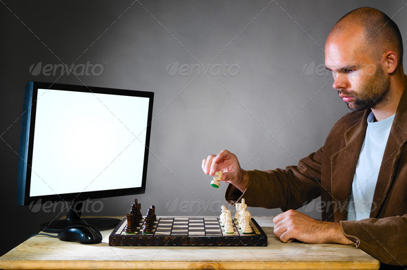 human chess player against computer - Stock Photo - Images