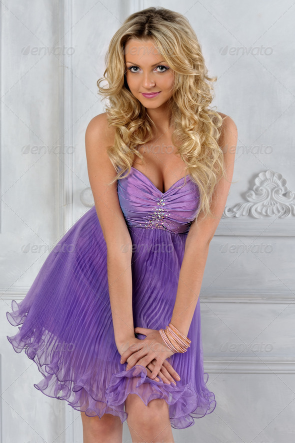 Beautiful blonde woman in lilac short dress. - Stock Photo - Images