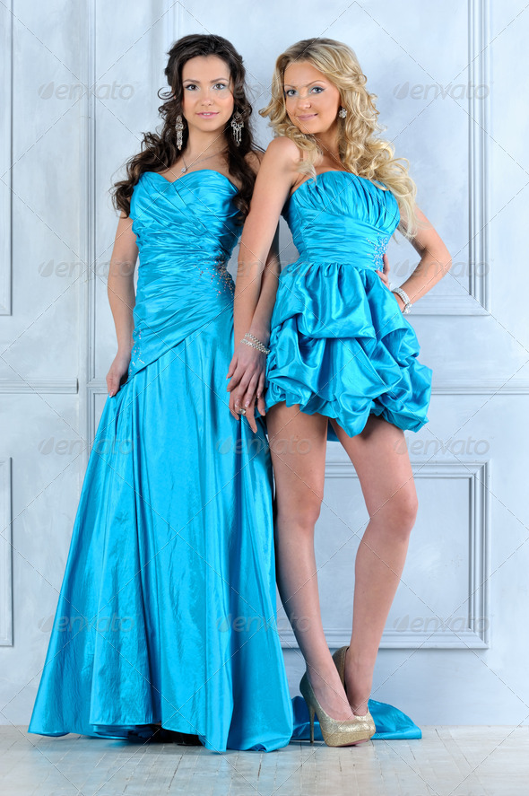 Two beautiful women in long and short evening dresses. - Stock Photo - Images
