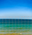 net over blue sky and sea waves - PhotoDune Item for Sale