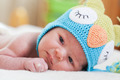 newborn baby in a bright knitted hat - PhotoDune Item for Sale
