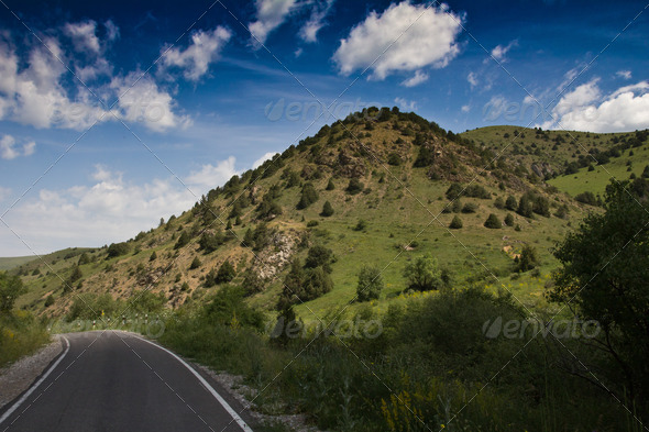 The road to the mountains on the nature - Stock Photo - Images