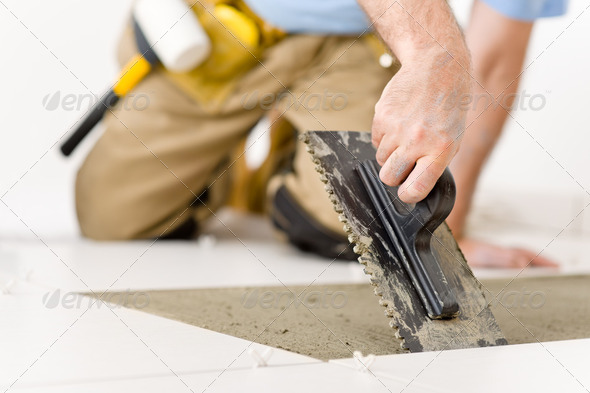 Stock Photo - PhotoDune Home Improvement Renovation Handyman Laying Tile 226023
