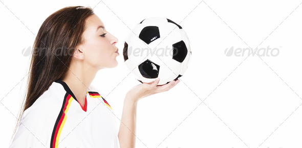 beautiful young woman kissing a football - Stock Photo - Images