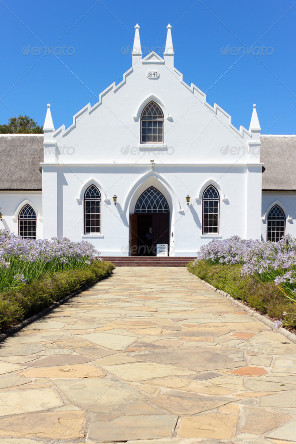 White Church in Franschhoek in front of blue sky - Stock Photo - Images