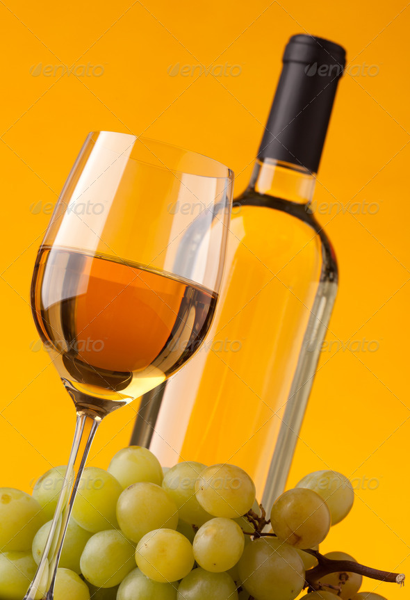 Bottom view of a glass of white wine bottle and grapes - Stock Photo - Images