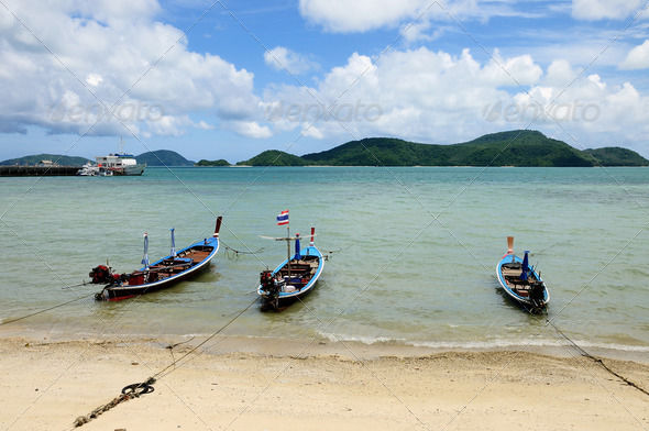 Three motor boats stay on the beach. - Stock Photo - Images