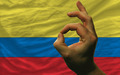 ok gesture in front of colombia national flag - PhotoDune Item for Sale