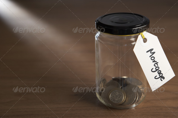 Coins in a jam jar - Stock Photo - Images