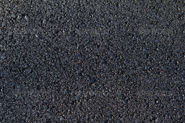 new asphalt laid on the road - Stock Photo - Images