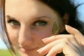 Butterfly on Woman hand with face on background - PhotoDune Item for Sale