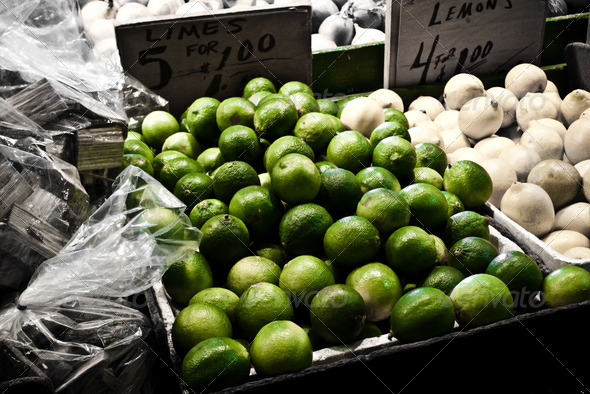 Limes and Lemons for sale at a farmers market - Stock Photo - Images