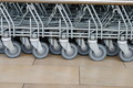 wheels of shopping  trolleys in a row - PhotoDune Item for Sale