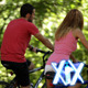 Couple Riding Bicycles At Park - VideoHive Item for Sale