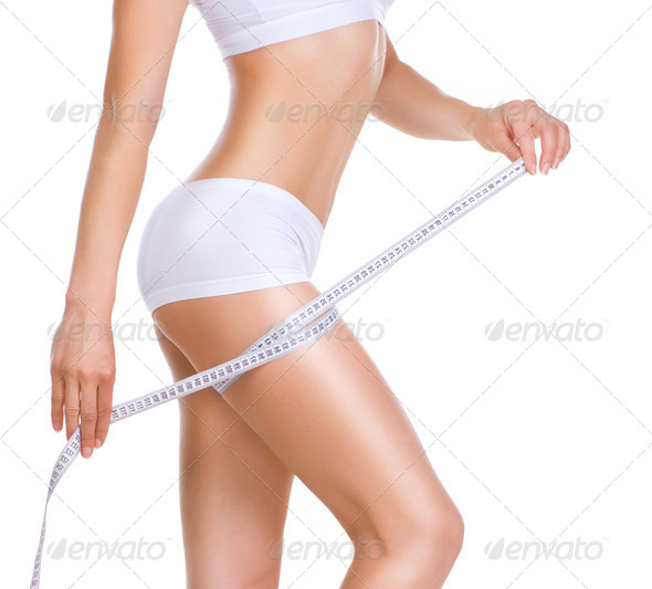 Woman Measuring Her Perfect Body. Healthy lifestyle concept - Stock Photo - Images