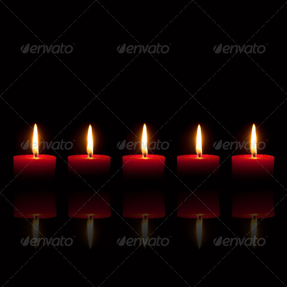 Five red candles burning in front of black background - Stock Photo - Images