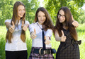 Three Happy Student Girl With Thumbs-Up In The Park - PhotoDune Item for Sale