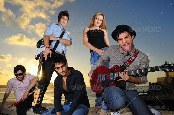 Group of hispanic young musicians posing