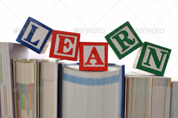 Alphabet Blocks spelling the words learn  - Stock Photo - Images