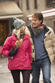 Couple Walking Along Snowy Town Street In Ski Resort - PhotoDune Item for Sale