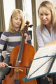 Girl playing cello in music lesson - PhotoDune Item for Sale