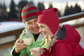 Couple Enjoying Hot Drink In Caf At Ski Resort - PhotoDune Item for Sale