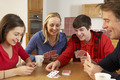 Family Playing Cards In Kitchen - PhotoDune Item for Sale