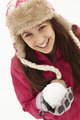 Teenage Girl Holding Snowball Wearing Fur Hat - PhotoDune Item for Sale