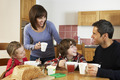 Family Eating Breakfast Together In Kitchen - PhotoDune Item for Sale