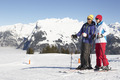 Couple Having Fun On Ski Holiday In Mountains - PhotoDune Item for Sale