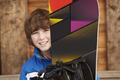 Boy With Snowboard On Ski Holiday In Front Of Wooden Background - PhotoDune Item for Sale