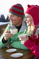 Couple Enjoying Hot Drink In Café At Ski Resort - PhotoDune Item for Sale