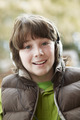 Boy Wearing Headphones And Listening To Music Wearing Winter Clothes - PhotoDune Item for Sale