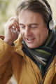 Man Wearing Headphones And Listening To Music Wearing Winter Clothes - PhotoDune Item for Sale