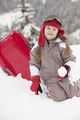 Young Girl Playing In Snow With Sledge On Ski Holiday In Mountains - PhotoDune Item for Sale